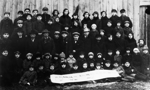 When Sam Naimark was about 10 years old he joined the Zionist organization, Hashomer Hatzair, in Turiysk, Poland. He is shown here with the group, in the top row, third from left.
