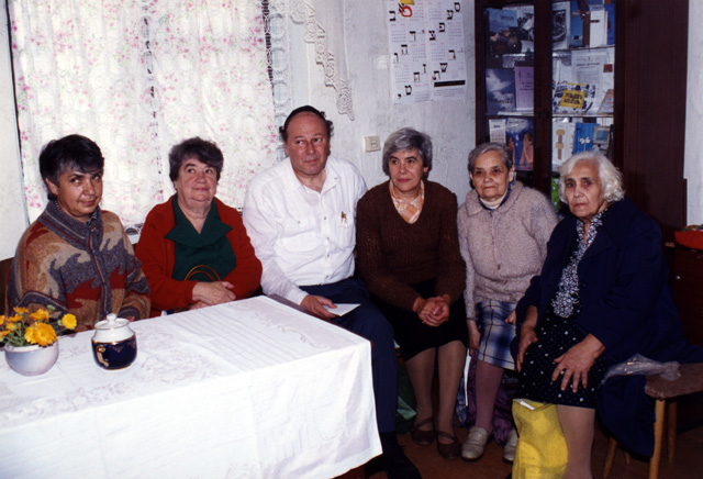 One of the women on the left is Rosa Hardurskya, daughter of Joseph Goldman. (Her mother was Hannah H. Chiem, daughter of Usher). The other woman's name is not known. Next to Paul Gass on the right are Genya Goldman (who is a Goldman by birth and marriage) and Yesheva Goldman and Ida Goldman who are sisters-in-law. (Ida married Shmuel, and Yesheva married Moishe, both sons of Israel Goldman.) We learned later that Genya was indeed a relative.