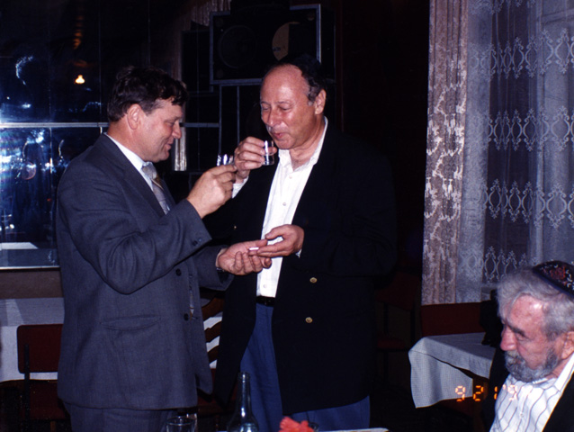 Paul and Leonty Nikolayevich, the assistant mayor of Novograd Volynsk, toasting each other during the banquet