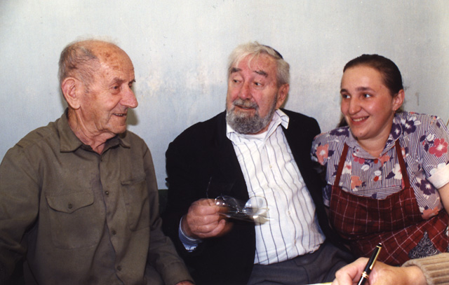 Chaim Spiegelman and his daughter converse with Baruch.