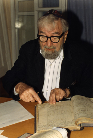 Baruch Korff at the Zhitomir ZAGS Archives, looking at the vital records for the Jewish inhabitants of Novograd Volynsk