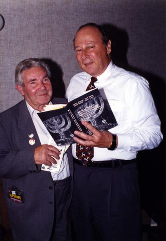 David Budnik, the last survivor of Babi Yar, presented Paul with a copy of his book describing his experiences.
