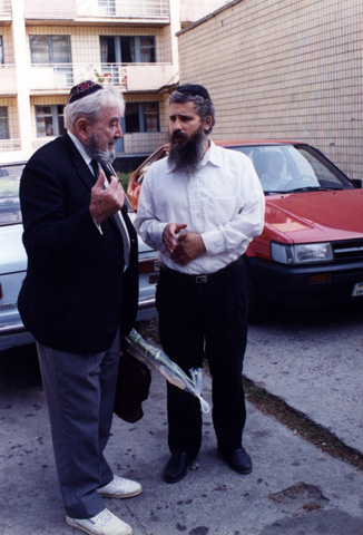 Baruch in conversation with the rabbi who met us at the airport